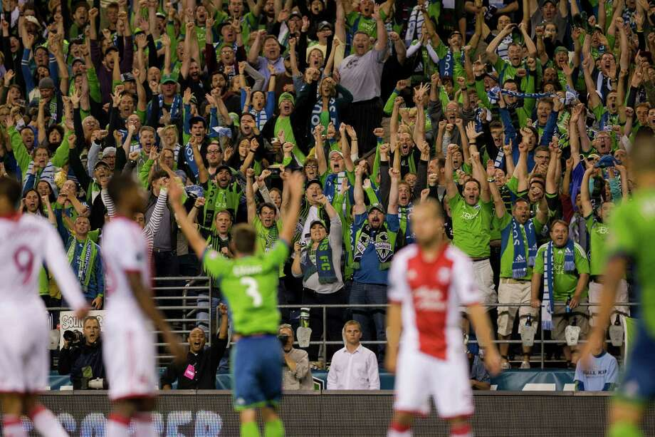 The stands react to Eddie Johnson's game-winning goal during the second half of the Cascadia Cup match Sunday, August 25, 2013, at CenturyLink Field in Seattle. The Sounders beat the Timbers 1-0. The sold-out match marked Clint Dempsey's first home game as a member of the Seattle Sounders FC. Photo: JORDAN STEAD, SEATTLEPI.COM / SEATTLEPI.COM
