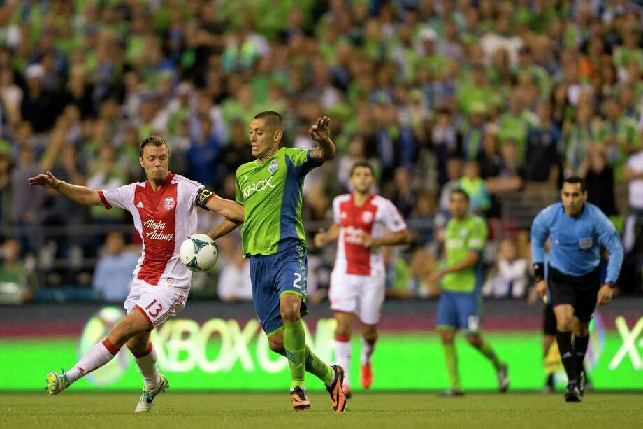 Clint Dempsey, center left, and Jack Jewsbury, left, chase after the ball during the second half of the Cascadia Cup match Sunday, August 25, 2013, at CenturyLink Field in Seattle. The Sounders beat the Timbers 1-0. The sold-out match marked Clint Dempsey's first home game as a member of the Seattle Sounders FC. Photo: JORDAN STEAD, SEATTLEPI.COM / SEATTLEPI.COM