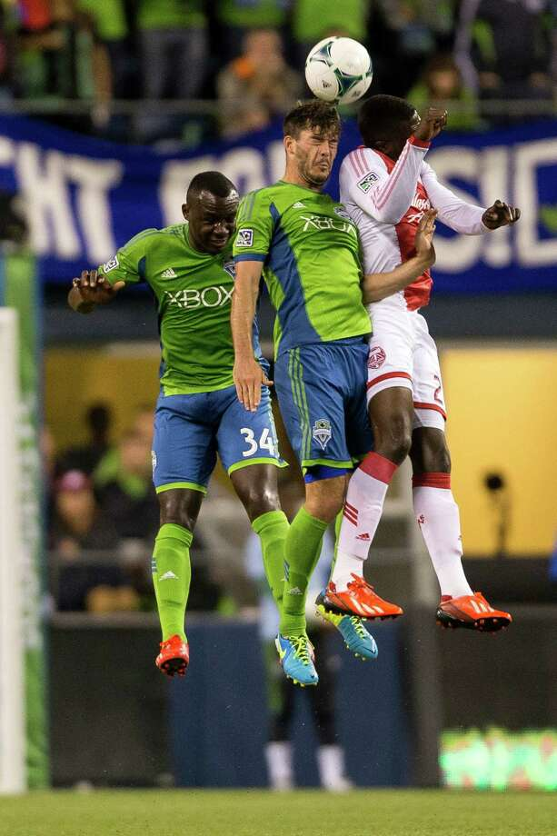 Sounders and Timbers players go up for a header during the second half of the Cascadia Cup match Sunday, August 25, 2013, at CenturyLink Field in Seattle. The Sounders beat the Timbers 1-0. The sold-out match marked Clint Dempsey's first home game as a member of the Seattle Sounders FC. Photo: JORDAN STEAD, SEATTLEPI.COM / SEATTLEPI.COM