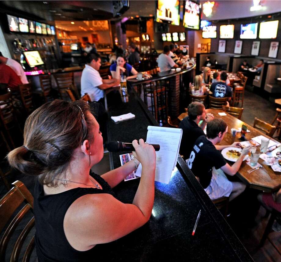 Kelsey Patrick runs through the first round of questions during Hump Day Trivia Night at Major League Grill on Wednesday, July 31, 2013. Photo taken: Randy Edwards/The Enterprise
