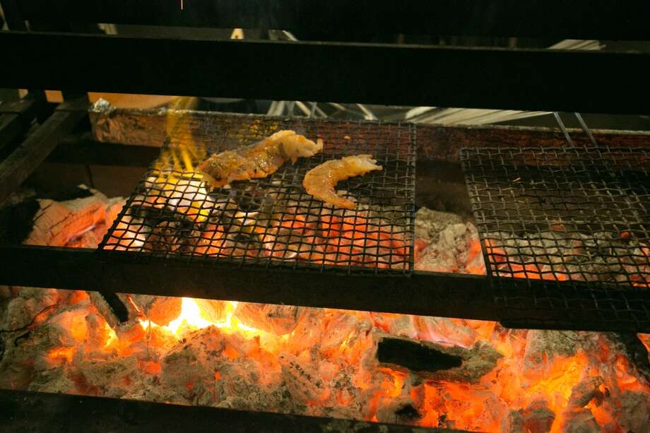 Prawns being cooked over coals at Roka Akor in San Francisco. Photo: John Storey, Special To The Chronicle