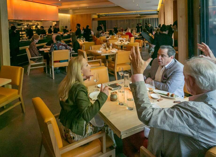 Diners enjoy dinner at Roka Akor in San Francisco. Photo: John Storey, Special To The Chronicle
