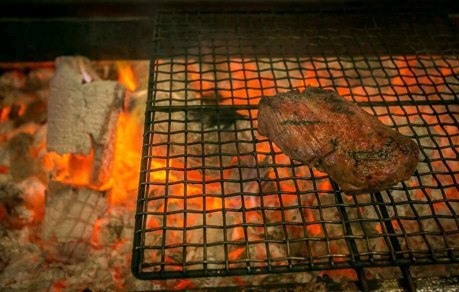 A steak filet cooking on the grill at Roka Akor in San Francisco. Photo: John Storey, Special To The Chronicle