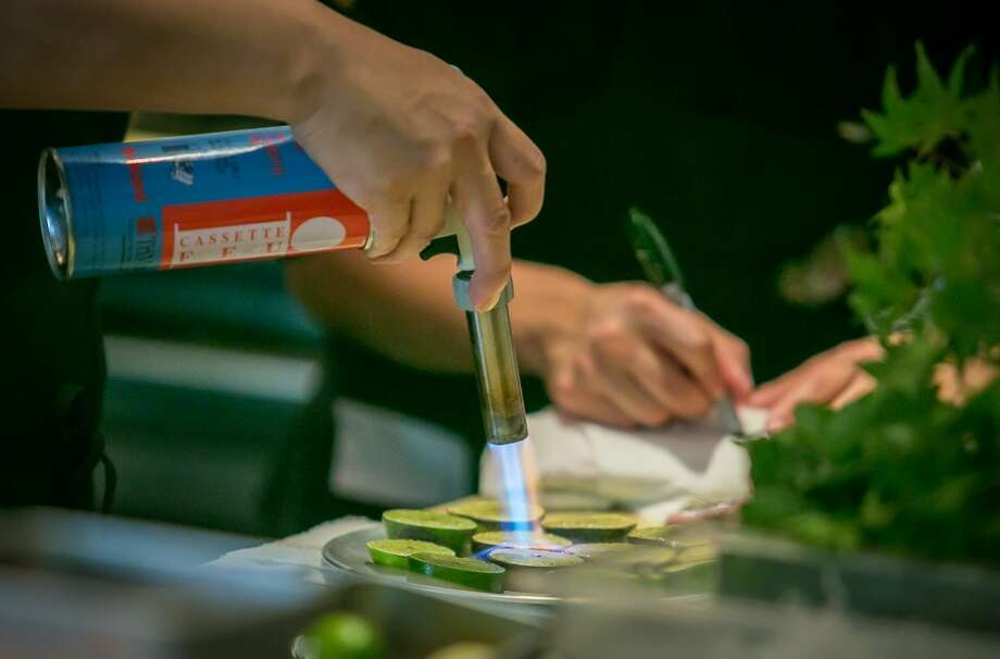 Limes being seared at Roka Akor in San Francisco. Photo: John Storey, Special To The Chronicle