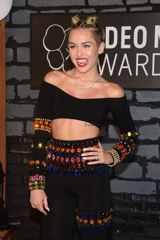 Miley Cyrus attends the 2013 MTV Video Music Awards at the Barclays Center on August 25, 2013 in the Brooklyn borough of New York City.  (Photo by Jamie McCarthy/Getty Images for MTV) Photo: Jamie McCarthy, Getty Images For MTV