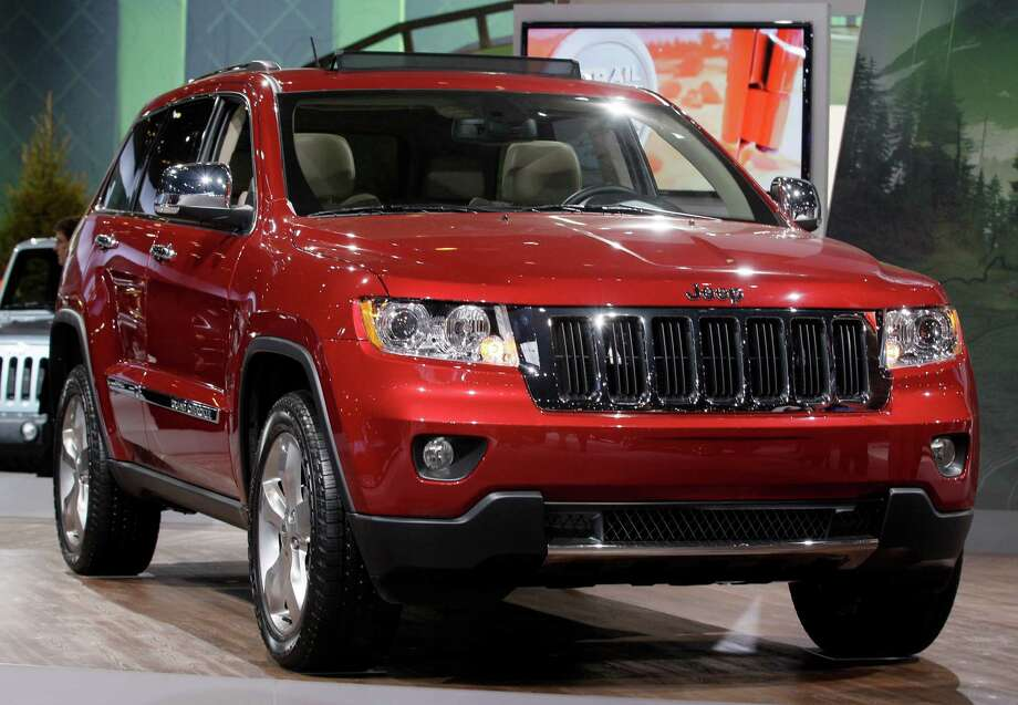 FILE - This Feb. 8, 2012, file photo, shows a Jeep Grand Cherokee during the media preview of the Chicago Auto Show at McCormick Place in Chicago. U.S. auto safety regulators are investigating complaints that the ceilings can catch fire in 2012 Jeep Grand Cherokee SUVs. The probe, announced Friday, Aug. 23, 2013, by the National Highway Traffic Safety Administration, covers an estimated 146,000 of the popular sport utility vehicles. Photo: Nam Y. Huh