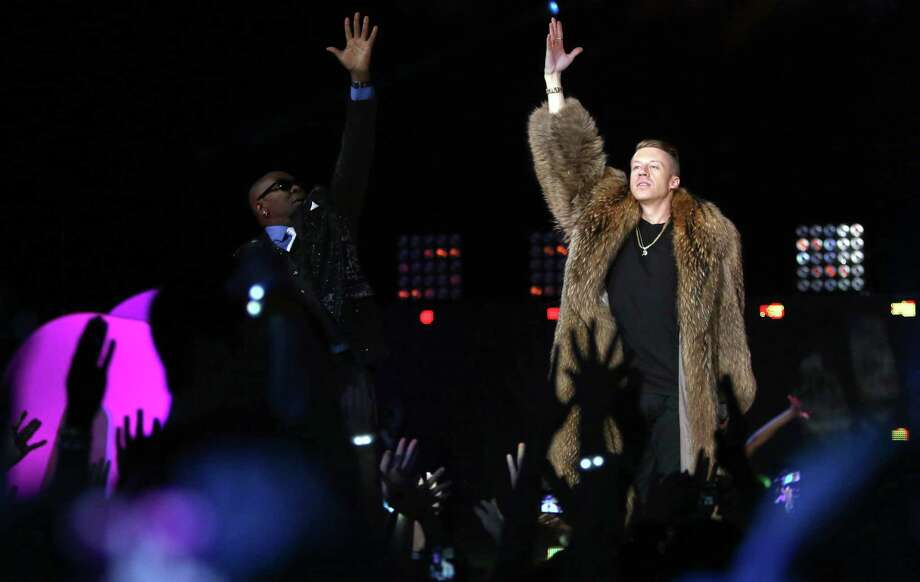 "Wanz and Macklemore perform their song ""Thrift Shop"" during We Day on Wednesday, March 27, 2013, at KeyArena in Seattle. The event brought thousands of middle and high school students together to hear from a list of celebrities and motivational speakers. We Day is a youth educational and empowerment event organized by the Free the Children charity. Students earn a seat at the event through their commitment to do good. (Joshua Trujillo, seattlepi.com) Photo: JOSHUA TRUJILLO, Seattlepi.com File Photo / SEATTLEPI.COM"