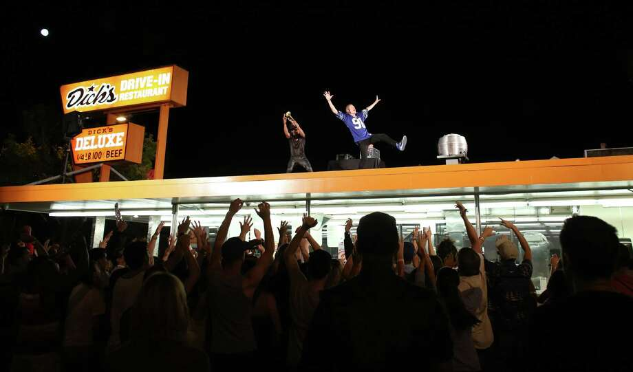 """Macklemore and Ryan Lewis perform for a video shoot on Wednesday, July 24, 2013, on the roof of the Capitol Hill Dick's Drive-In in Seattle. Macklemore and Ryan Lewis were working with a crew to shoot a video for their song """"White Walls."""" Thousands of people showed up for the video shoot after word of the shoot was leaked onto social media earlier in the day. The shoot was delayed because of the large crowd that showed up on Broadway Avenue. (Joshua Trujillo, seattlepi.com) Photo: JOSHUA TRUJILLO, Seattlepi.com File Photo / SEATTLEPI.COM"""