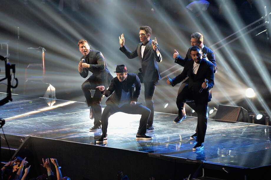 The *NSYC reunion happened! Thirtysomething women everywhere rejoice! (L-R) Chris Kirkpatrick, Joey Fatone, Justin Timberlake, JC Chasez and Lance Bass of 'N Sync perform. Photo: Rick Diamond, Getty Images For MTV