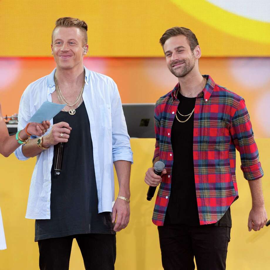 "Macklemore (L) and Ryan Lewis perform on ABC's ""Good Morning America"" at Rumsey Playfield, Central Park on Aug. 16, 2013, in New York City.  (Photo by D Dipasupil/FilmMagic) Photo: D Dipasupil, Getty / 2013 D Dipasupil"