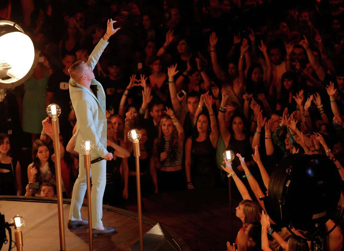Macklemore performs onstage during the 2013 MTV Video Music Awards.