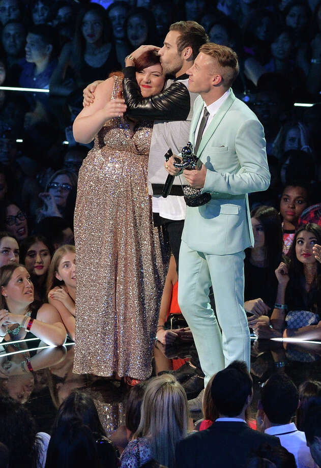 Mary Lambert, Ryan Lewis and Macklemore accept their VMA onstage during the 2013 MTV Video Music Awards. Photo: Rick Diamond, Getty / 2013 Getty Images