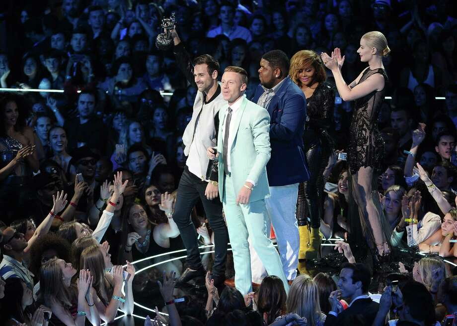 Ryan Lewis (L), Macklemore, Ray Dalton, Lil Kim, and Iggy Azalea onstage during the 2013 MTV Video Music Awards at the Barclays Center on Sunday.  Photo: Jemal Countess, Getty / 2013 FilmMagic