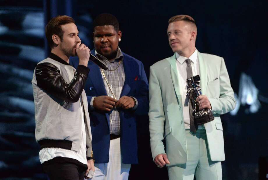 Ryan Lewis, Ray Dalton, and Macklemore speak onstage during the 2013 MTV Video Music Awards at the Barclays Center on Sunday. Photo: Jeff Kravitz, Getty / 2013 Jeff Kravitz