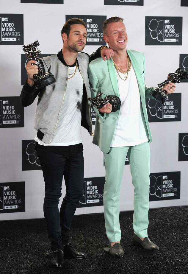 Ryan Lewis and Macklemore attend the 2013 MTV Video Music Awards. Photo: Jamie McCarthy, Getty / 2013 Getty Images