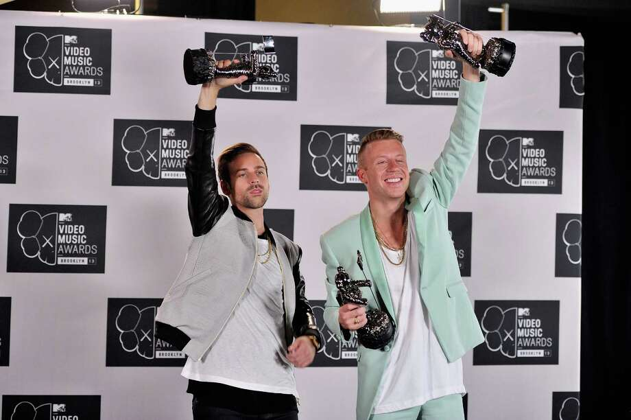 Ryan Lewis and Macklemore pose with their three awards at the 2013 MTV Video Music Awards. Photo: Stephen Lovekin, Getty / 2013 FilmMagic