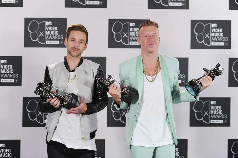 Ryan Lewis and Macklemore pose with award in the press room at the 2013 MTV Video Music Awards. Photo: Dimitrios Kambouris, Getty / 2013 WireImage