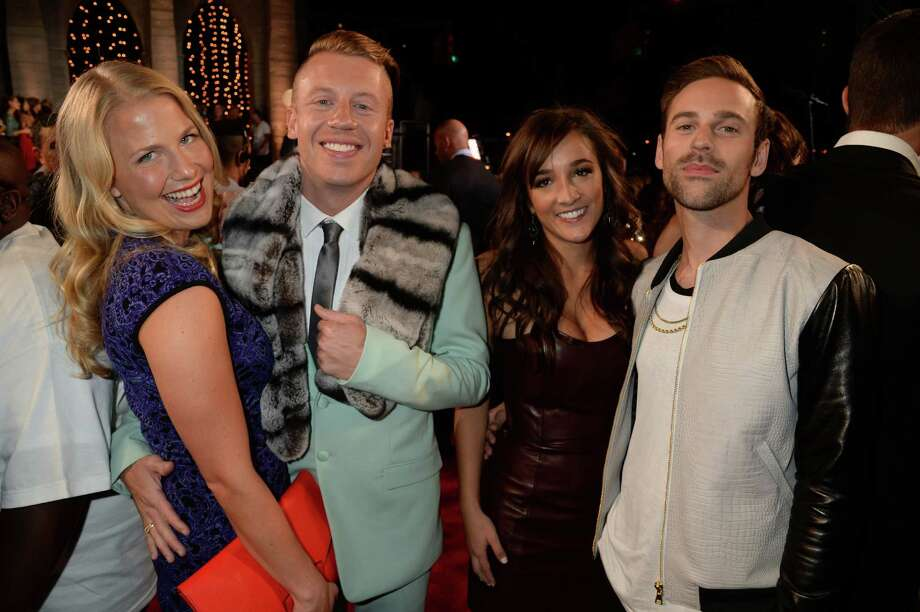 Tricia Davis, Macklemore, guest, Ryan Lewis attend the 2013 MTV Video Music Awards. Photo: Jeff Kravitz, Getty / 2013 Jeff Kravitz