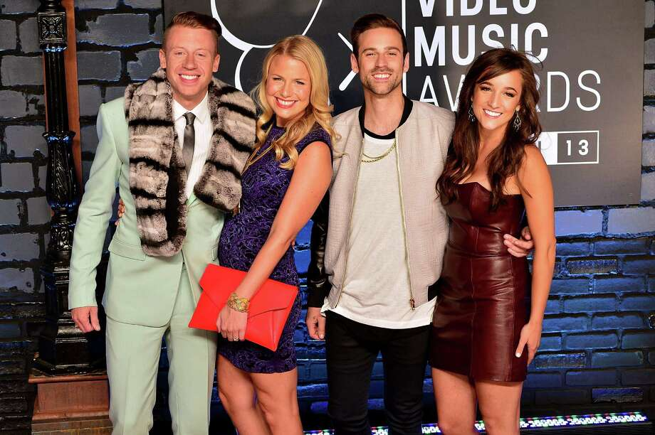 Macklemore, Tricia Davis, Ryan Lewis and guest attend the 2013 MTV Video Music Awards. Photo: James Devaney, Getty / 2013 James Devaney