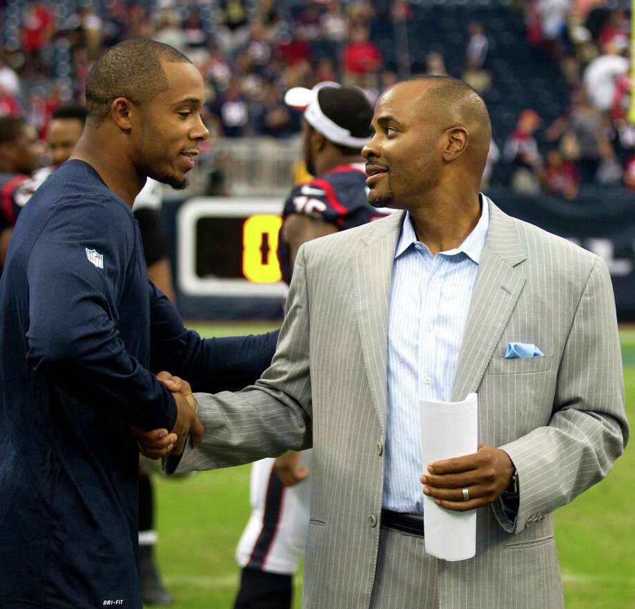 Houston Texans wide receiver DeVier Posey, left, talks to general manager Rick Smith following the Texans loss to the New Orleans Saints in a pre-season game at Reliant Stadium on Sunday, Aug. 25, 2013, in Houston. Photo: Brett Coomer, Houston Chronicle / © 2013  Houston Chronicle