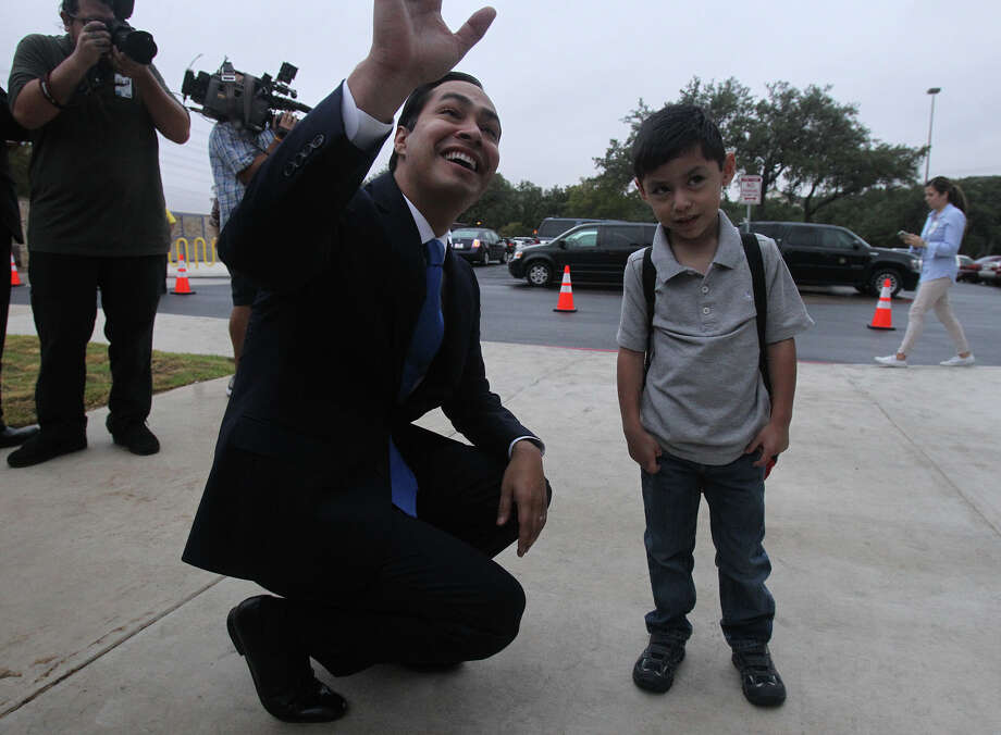 San Antonio Mayor Julian Castro (left) greets supporters Monday August 26, 2013 at the Pre-K 4 SA North Education Center with student Ethan Harding,4, on the first day of school. The tax-funded citywide program is considered Castro's signature education initiative. Photo: JOHN DAVENPORT, SAN ANTONIO EXPRESS-NEWS / ©San Antonio Express-News/Photo may be sold to the public