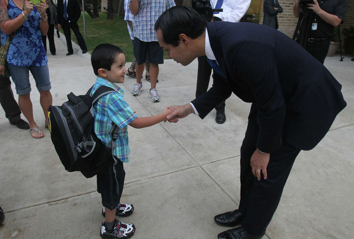 San Antonio Mayor Julian Castro (right) greets student Ricky Rendon,4, Monday August 26, 2013 at the Pre-K 4 SA North Education Center on the first day of school. The tax-funded citywide program is considered Castro's signature education initiative.