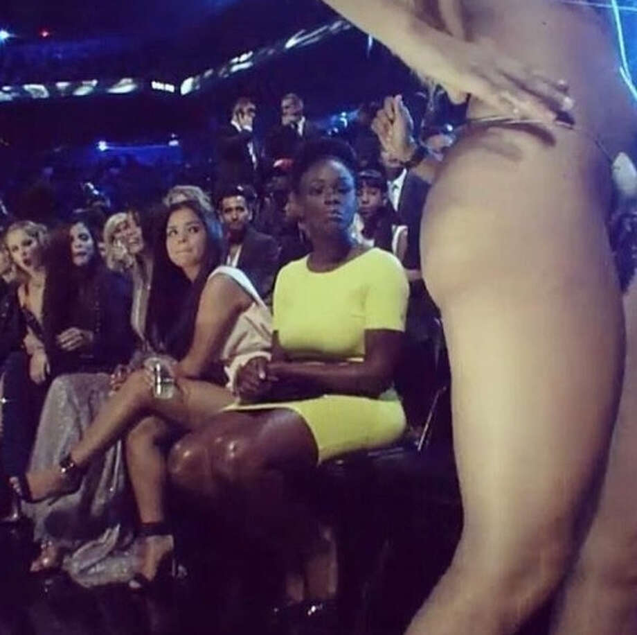Here's a shot of a whole row of people, including Taylor Swift, staring at Lady Gaga's bare behind, in a thong-fit that she donned all night. Photo: Takemeswiftly.tumblr.com