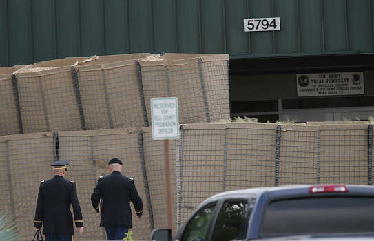 Members of the prosecution enter the Lawrence Williams Judicial Center for the sentencing phase of the Maj. Nidal Hasan capital murder trial begins on Monday, Aug. 26, 2013 at Fort Hood. Photo: Jerry Lara, San Antonio Express-News / ©2013 San Antonio Express-News