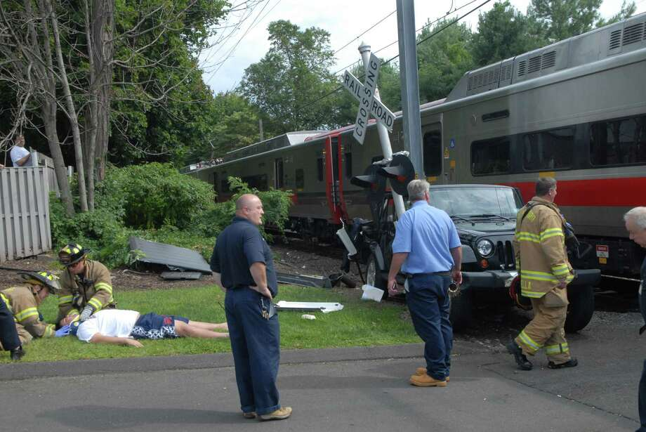 A car train accident at the railroad crossing at 9 Riverbend on Hope St in Stamford, Conn. on Monday August 26, 2013. Photo: Dru Nadler / Stamford Advocate Freelance