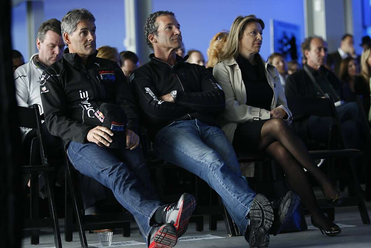 Team Oracle's own helmsman Russell Coutts (left) and five-time America's Cup veteran Paul Cayard (middle) listen to a press conference about this year's America Cup at Pier 27 in San Francisco, California, on Wednesday, April 3, 2013.