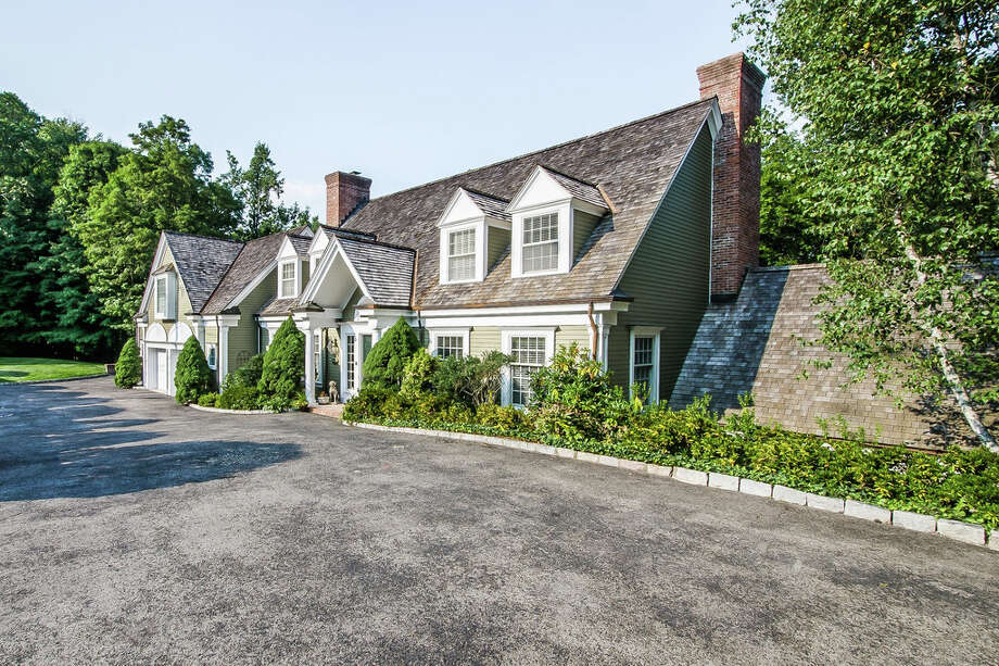 The custom-built house at 269 Valley Road in New Canaan, on the market for $2,295,000, is situated along the Silvermine River. Photo: Contributed