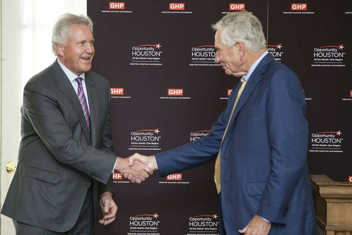 Jeff Immelt, president and CEO of GE, left, greets Drayton McLane Jr., chairman of Opportunity Houston 2.0.