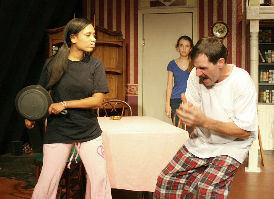 "Steve, played by Tim Huebenthal, gets what's coming to him from Johanna, played by Jasmin Barbosa, as Jean, played by Livi Woods, looks on, in ""August: Osage County,"" opening Friday, Sept. 6 at the Ridgefield Theater Barn. Photo: Contributed Photo"