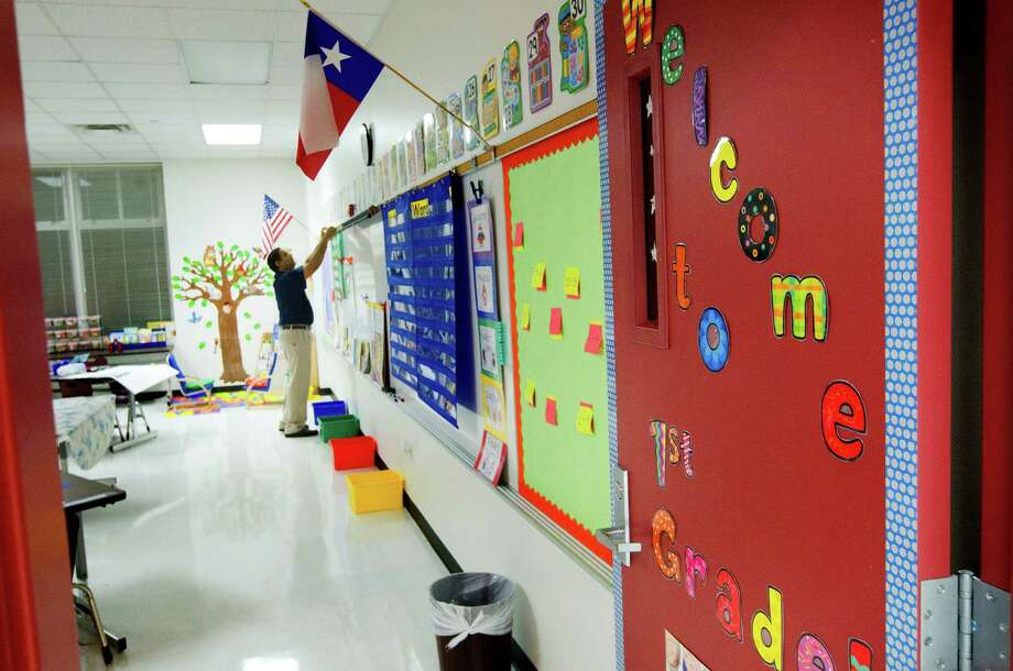 Norvis Boodram prepares his first grade classroom during the first day of school at Thurgood Marshall Elementary, Monday, Aug. 26, 2013, in Houston. The school is a former North Forest school being absorbed by the Houston Independent School District. Photo: Cody Duty, Houston Chronicle / © 2013 Houston Chronicle