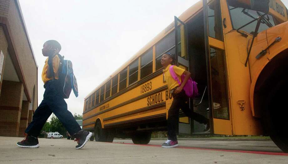 Jasmine wells, 9, follows her brother, David wells, 7, left, as they arrive during the first day of school at Thurgood Marshall Elementary, Monday, Aug. 26, 2013, in Houston. The school is a former North Forest school being absorbed by the Houston Independent School District. Photo: Cody Duty, Houston Chronicle / © 2013 Houston Chronicle