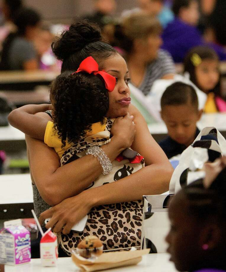 "Josie Roberts hugs her daughter, Kyndall Roberts, 5, during the first day of school at Thurgood Marshall Elementary, Monday, Aug. 26, 2013, in Houston. ""I cried last year, I'm not going to cry this year,"" Josie said. The school is a former North Forest school being absorbed by the Houston Independent School District. Photo: Cody Duty, Houston Chronicle / © 2013 Houston Chronicle"