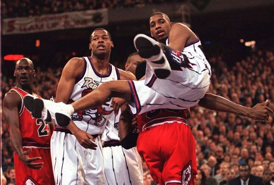 1997-98 seasonAs a rookie, McGrady (shown here on the back of Scottie Pippen) played in 64 games and had averages of 7.0 points, 4.2 rebounds and 1.5 assists per game. Photo: Rene Johnston, Associated Press