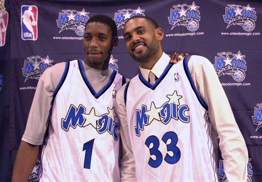 2000 free agency McGrady joined Grant Hill (right) in signing with the Orlando Magic. Photo: Peter Cosgrove, Associated Press