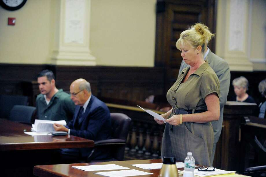 Vicki Hart, the mother of Nikki Hart, reads her victim's impact statement during the sentencing of Jason Guynup, far left, in the murder of Nikki Hart at the Rensselaer County Court House on Monday, Aug. 26, 2013 in Troy, NY.  (Paul Buckowski / Times Union) Photo: Paul Buckowski / 00023631A