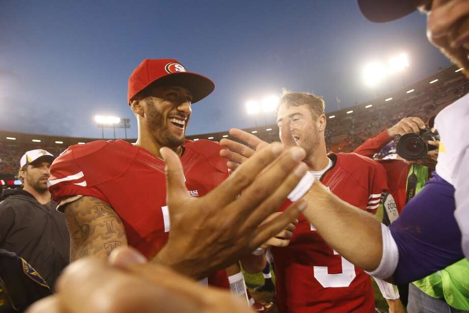 San Francisco 49ers quarterback Colin Kaepernick, left, shakes hands with a Minnesota Vikings player after defeating the Vikings 34-14 in his pre-season football game at Candlestick Park in San Francisco, Calif. on Aug. 25, 2013. Photo: Stephen Lam, Special To The Chronicle
