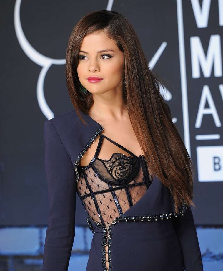 Selena Gomez manages to look more glamorous than trashy with this risque look. Maybe it's because she's not trying to lick her own eyeball? Photo: Dimitrios Kambouris, WireImage
