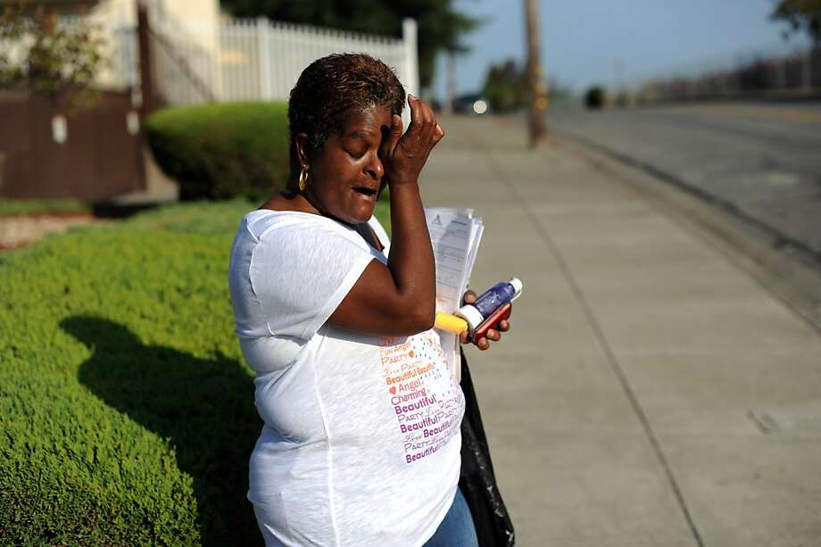 Rachelle Hammond, who suffers from COPD, waits outside her home in San Leandro for a ride to her weekly appointment at the Eastmont Wellness Center through the HealthPac program. Photo: Michael Short, Special To The Chronicle