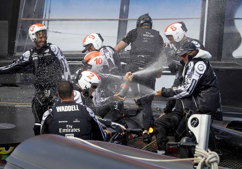 The crew aboard the Emirates catamaran broke out some champagne delivered after their victory Sunday August 25, 2013. Emirates New Zealand won the Louis Vuitton Cup defeating Luna Rossa Challenge 7-1 and now will face the Oracle team for America's Cup beginning in September. Photo: The Chronicle