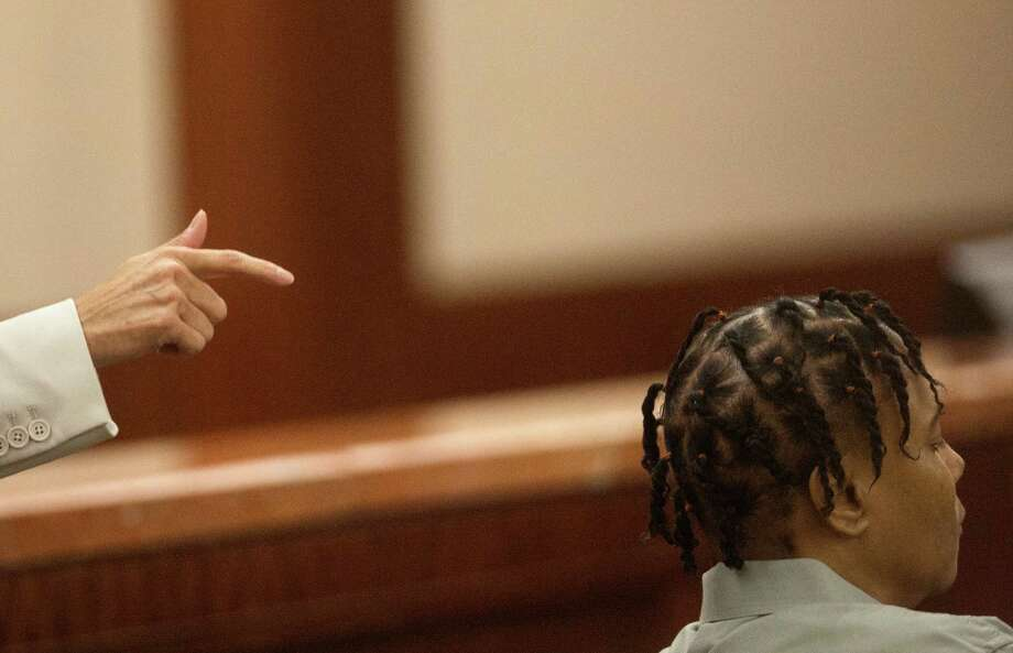 Mona Nelson, right, sits , as prosecutor Connie Spence gives her closing argument during Nelson's trial at the Harris County Criminal Courthouse, Monday, Aug. 26, 2013, in Houston. Nelson is on trial for the murder of 12-year-old Jonathan Foster in 2010. Photo: Cody Duty, Houston Chronicle / © 2013 Houston Chronicle