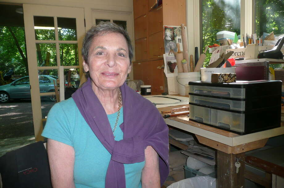 Greenwich artist Florence Suerig, seen at work in her backcountry studio, plans a multimedia art work to mark her 80th year. Photo: Picasa, Anne W. Semmes