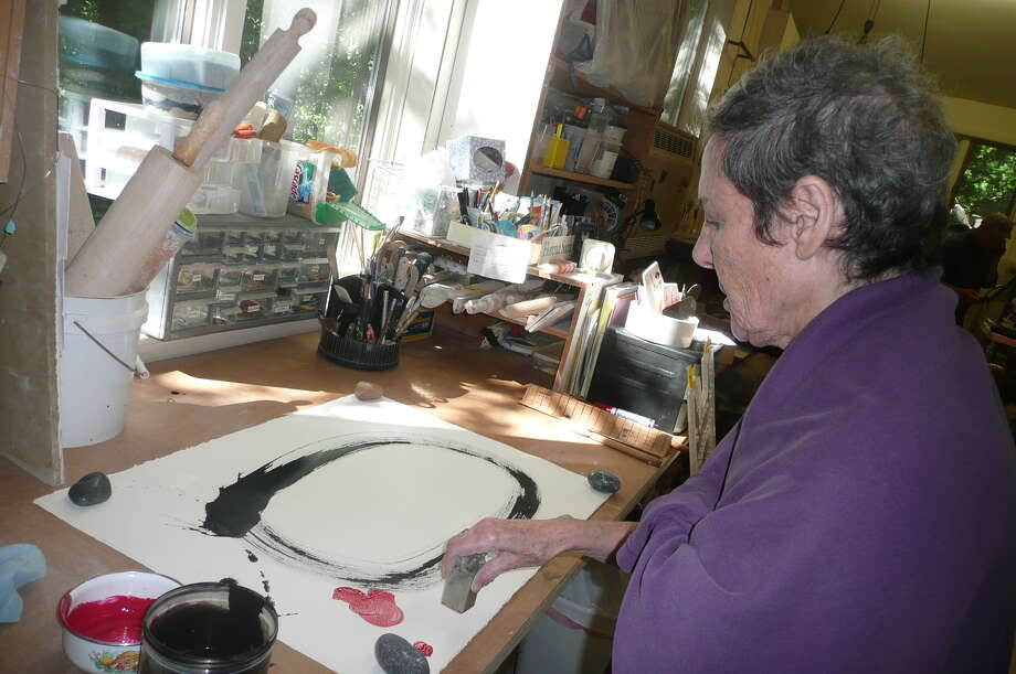 Greenwich artist Florence Suerig, seen at work in her backcountry studio, plans a multimedia art work to mark her 80th year. Photo: Anne W. Semmes