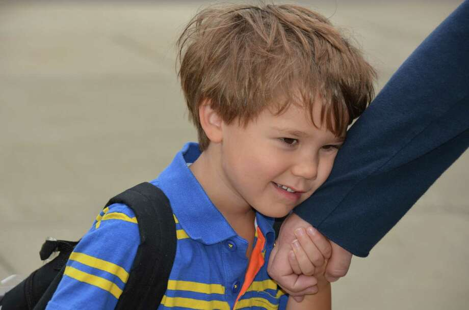 Kindergartner Marc Raisanen holds tight to his dad on the first day of school, August 26, 2013, at South School in New Canaan, Conn. Photo: Jeanna Petersen Shepard / New Canaan News Freelance