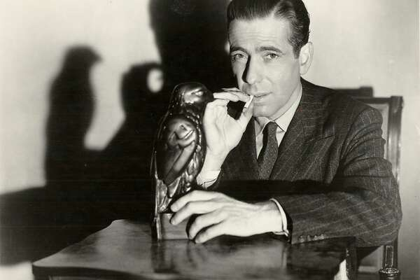"BOGART/C/17DEC99/DD/HO-Humphrey Bogart starred in ""The Maltese Falcon."" HANDOUT  ALSO RAN 3/13/02, 01/14/03, 12/6/03  Ran on: 02-07-2005 Humphrey Bogart, as Private Detective Sam Spade, poses with the object of desire in &quo;The Maltese Falcon.'' Ran on: 02-13-2007 Above: John Konstin, owner of John's Grill, leans disconsolately against the case the bird was taken from. Right: Humphrey Bogart, who may have dropped the statue on his toe while making the movie, in a still from the film in his role as Sam Spade. ALSO Ran on: 02-13-2007 Above: John Konstin, owner of John's Grill, leans disconsolately against the case the bird was taken from. Right: Humphrey Bogart, who may have dropped the statue on his toe while making the movie, in a still from the film in his role as Sam Spade."