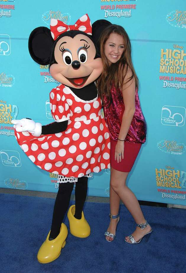 "Minnie Mouse and actress Miley Cyrus arrive at the premiere of ""High School Musical 2"" on August 14, 2007 at Disneyland, in Anaheim, Calif. Photo: Steve Granitz, WireImage / 2007 Steve Granitz"