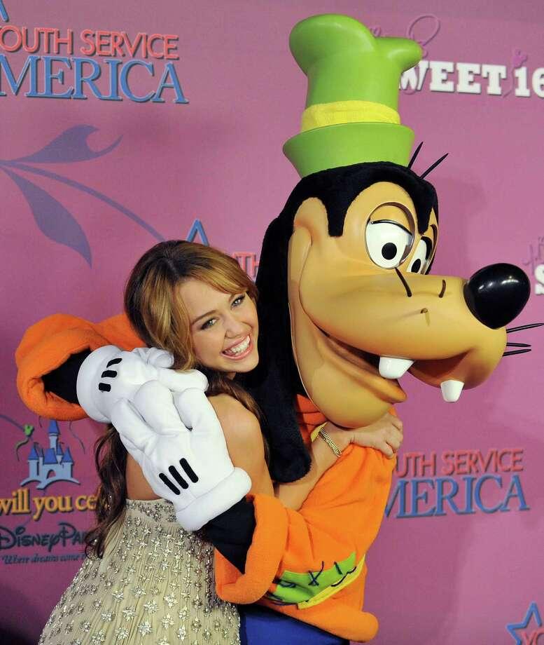 "Pluto helped wish Miley Cyrus a happy birthday during her ""Sweet 16"" Celebration on October 5, 2008 at Disneyland, in Anaheim, Calif. Photo: Jon Kopaloff, FilmMagic / 2008 Jon Kopaloff"